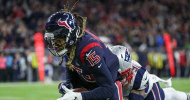 Houston Texans wide receiver Will Fuller (15) attempts to make a reception during the third quarter against the New England Patriots at NRG Stadium.