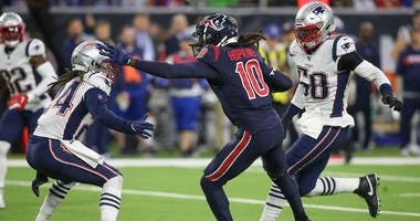 Houston Texans wide receiver DeAndre Hopkins (10) stiff arms New England Patriots cornerback Stephon Gilmore (24) in the second half at NRG Stadium.