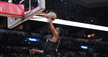 Houston Rockets guard James Harden's (13) dunk in the second half wraps through the basket during the game against the San Antonio Spurs at the AT&T Center. The basket was not credited to Harden.