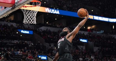 Houston Rockets guard James Harden (13) goes up for a dunk in the second half against the San Antonio Spurs at the AT&T Center.