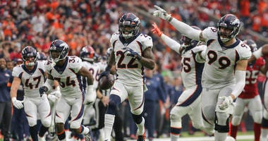 Denver Broncos strong safety Kareem Jackson (22) celebrates with teammates after an interception during the fourth quarter against the Houston Texans at NRG Stadium.