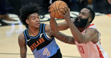 Houston Rockets guard James Harden (13) drives against Cleveland Cavaliers guard Kevin Porter Jr. (4) in the fourth quarter at Rocket Mortgage FieldHouse.