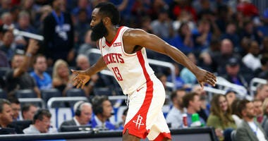 Houston Rockets guard James Harden (13) celebrates as he makes a three point basket against the Orlando Magic during the second half at Amway Center.