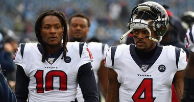 Houston Texans quarterback Deshaun Watson (4) and Houston Texans wide receiver DeAndre Hopkins (10) walk off the field after warmups before the game against the Tennessee Titans at Nissan Stadium.