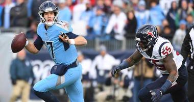 Tennessee Titans quarterback Ryan Tannehill (17) scrambles away from pressure from Houston Texans inside linebacker Benardrick McKinney (55) during the first half at Nissan Stadium.
