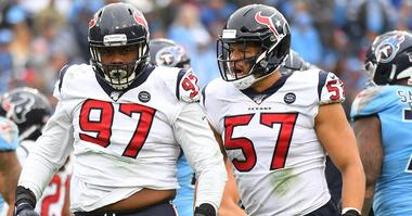 Houston Texans defensive end Angelo Blackson (97) and Houston Texans outside linebacker Brennan Scarlett (57) after a stop on a run from Tennessee Titans running back Derrick Henry (22) during the second half at Nissan Stadium.