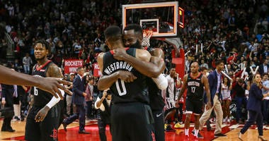 Houston Rockets guard Russell Westbrook (0) and guard James Harden (13) embrace after the Rockets defeated the San Antonio Spurs at Toyota Center.