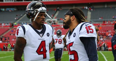 Houston Texans quarterback Deshaun Watson (4) and wide receiver Will Fuller (15) talk against the Tampa Bay Buccaneers prior to the game at Raymond James Stadium.
