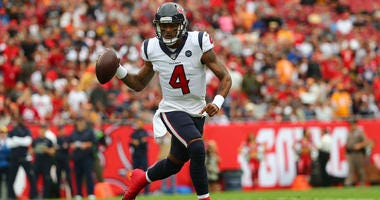Houston Texans quarterback Deshaun Watson (4) runs out of the pocket against the Tampa Bay Buccaneers during the first quarter at Raymond James Stadium.
