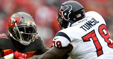 Tampa Bay Buccaneers linebacker Jason Pierre-Paul (90) rushes the passer as Houston Texans offensive tackle Laremy Tunsil (78) defends during the fourth quarter at Raymond James Stadium.