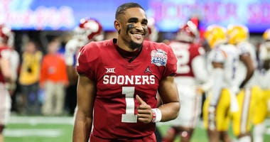 Oklahoma Sooners quarterback Jalen Hurts (1) reacts during the fourth quarter of the 2019 Peach Bowl college football playoff semifinal game between the LSU Tigers and the Oklahoma Sooners at Mercedes-Benz Stadium.