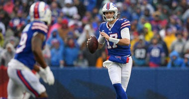 Buffalo Bills quarterback Josh Allen (17) looks downfield to pass against the New York Jets during the first quarter at New Era Field.