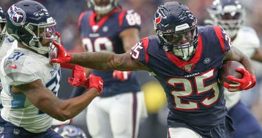 Houston Texans running back Duke Johnson (25) stiff arms Tennessee Titans free safety Kevin Byard (31) in the first quarter at NRG Stadium.