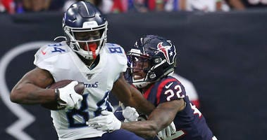 Tennessee Titans wide receiver Corey Davis (84) catches the ball against Houston Texans cornerback Gareon Conley (22) in the second quarter at NRG Stadium.