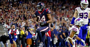 Houston Texans running back Taiwan Jones (34) celebrates after a catch during overtime against the Buffalo Bills in the AFC Wild Card NFL Playoff game at NRG Stadium.