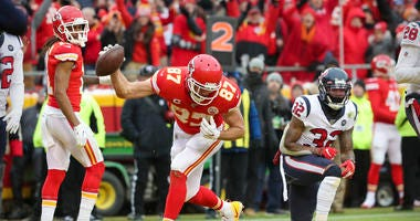 Kansas City Chiefs tight end Travis Kelce (87) scores a touchdown against the Houston Texans during the second quarter in a AFC Divisional Round playoff football game at Arrowhead Stadium.