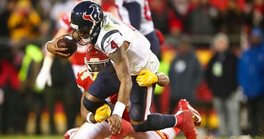 Houston Texans quarterback Deshaun Watson (4) is tackled by Kansas City Chiefs linebacker Dorian O'Daniel (44) during the fourth quarter in a AFC Divisional Round playoff football game at Arrowhead Stadium.