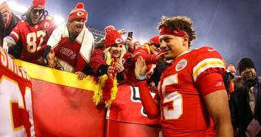 Kansas City Chiefs quarterback Patrick Mahomes (15) celebrates with fans after defeating the Houston Texans in a AFC Divisional Round playoff football game at Arrowhead Stadium.