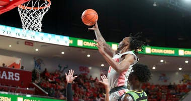 Houston Cougars guard DeJon Jarreau (3) goes up for a shot over South Florida Bulls guard Laquincy Rideau (3) during the second half at Fertitta Center.