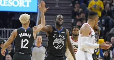 olden State Warriors forward Draymond Green (23) is congratulated by Ky Bowman (12) after scoring against the Houston Rockets during the first half of an NBA basketball game in San Francisco, Wednesday, Dec. 25, 2019.