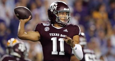 Texas A&M quarterback Kellen Mond (11) throws a pass during the first half of the team's NCAA college football game against LSU in Baton Rouge, La., Saturday, Nov. 30, 2019.