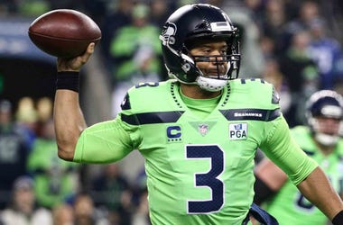 Russell Wilson of the Seattle Seahawks drops back to pass in a game against the Minnesota Vikings.