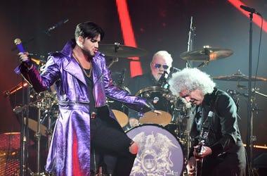 (L-R) Singer Adam Lambert, drummer Roger Taylor and guitarist Brian May of Queen