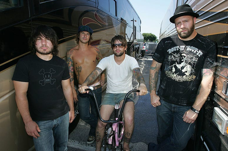 Musicians Jordan Buckley, Michael Novak Jr., Keith Buckley and Chris Byrnes of the band Every Time I Die pose backstage at the Vans Warped Tour on August 5, 2006 in Uniondale, New York