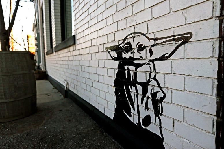 Artist Michael Cerda painted a baby Yoda onto Hotel Madrid in Walker's Point. Mjs Babyyoda00p1