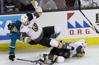 San Jose Sharks left wing Marcus Sorensen, from Sweden, left, and Vegas Golden Knights defenseman Colin Miller fall over Cody Eakin during the first period of Game 3 of an NHL hockey second-round playoff series in San Jose, Calif., Monday, April 30, 2018.