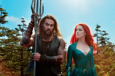 "This image released by Warner Bros. Pictures shows Jason Momoa, left, and Amber Heard in a scene from ""Aquaman."" (Warner Bros. Pictures via AP)"