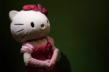 In this Thursday, Oct. 30, 2014 file photo, a model dressing as Japanese character Hello Kitty waits for guests to pose for a souvenir photo at Sanrio Puroland, a theme park featuring Hello Kitty in Tokyo. (AP Photo/Eugene Hoshiko, File)