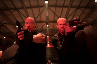 """This image released by Universal Pictures shows Dwayne Johnson, left, and Jason Statham in a scene from """"Fast & Furious Presents: Hobbs & Shaw."""" (Daniel Smith/Universal Pictures via AP)"""