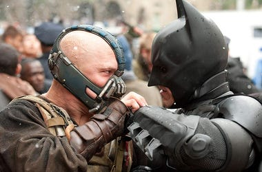 """Tom Hardy as 'Bane' and Christian Bale as 'Batman' in """"The Dark Knight Rises"""" (Photo credit: Warner Bros. Pictures)"""