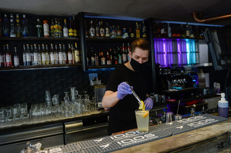 Bartender wearing mask