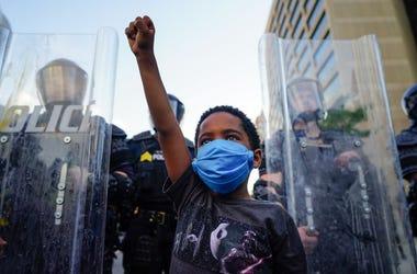 Kid protesting in Atlanta