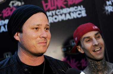 Musicians Tom DeLonge (L) and Travis Barker speak at a press party of announce the 2011 Honda Civic Tour featuring blink-182 and My Chemical Romance at the Rainbow Bar and Grill on May 23, 2011 in West Hollywood, California