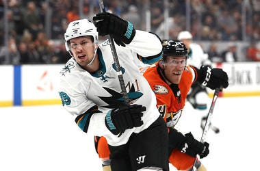 ANAHEIM, CALIFORNIA - OCTOBER 05: Logan Couture #39 of the San Jose Sharks eludes the defense of Carter Rowney #24 of the Anaheim Ducks during the second period of a game at Honda Center on October 05, 2019 in Anaheim, California. (Photo by Sean M. Haffey