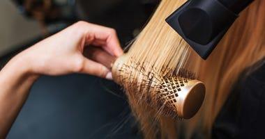 women getting a haircut