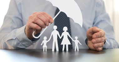 insurance as an umbrella covering a family