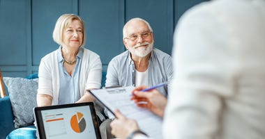 older couple getting financial counseling