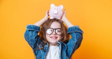 young girl with a piggy bank