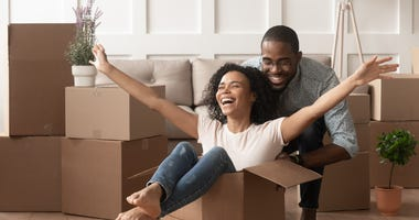 young couple celebrating a new home purchase