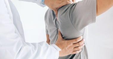 doctor working on a shoulder
