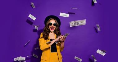 woman throwing money into the air like rain