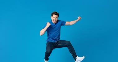 man celebrating with a jump kick