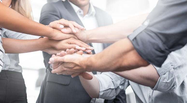 all in team handshake at work