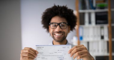 man holding a paycheck