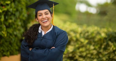 girl wearing graduation cap and gown