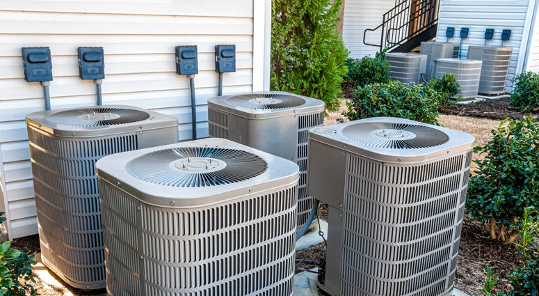 air conditioning units outside of a town house